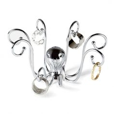 "GOT IT!!!!    www.givesimple.com $10 Allow this charming sea creature to drape your rings around its 8 tentacles.       Size: 4 x 3 1/2 x 2 3/4"" (10 x 9 x 7 cm)   Material : Chrome plated cast metal"