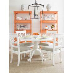 tangerine bookshelves, lantern pendant, white pedestal