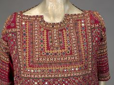 Woman's shirt from Kutch, Gujarat, India, IMA 2 - Embroidery of India - Wikipedia, the free encyclopedia Embroidery Suits Punjabi, Embroidery On Kurtis, Hand Embroidery Dress, Kurti Embroidery Design, Embroidered Clothes, Embroidery Fashion, Creative Embroidery, Fancy Dress Design, Stylish Dress Designs