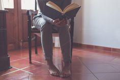Barefoot and reading a book by Seronda Estudio on Creative Market