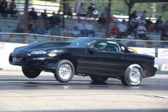 A fourth gen Chevy #Camaro lifts the tires at #LSFest 2012