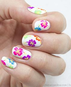 Headed on vacation? Opt for brighter blossoms like the ones in this manicure. For a less bold take, use the same technique but with pastel polish instead of neons. See the tutorial at Divine Caroline.