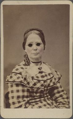 ca. 1860, [carte de visite portrait of a woman, possibly blind, wearing dark glasses and a plaid dress], J.P. Blessing  Co.  via the Southern Methodist University, Lawrence T. Jones III Texas Photography Collection