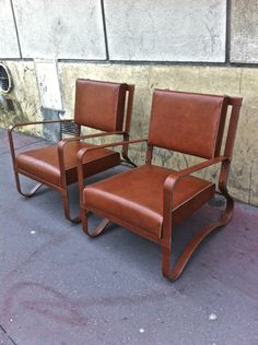 Jacques Adnet; Leather Over Metal Lounge Chairs, 1940s.
