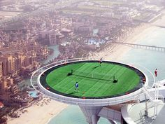 The worlds highest tennis court hovering 1000 feet above the ocean at the luxury hotel, Burj al Arab in Dubai