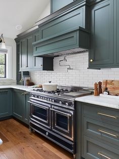 shaker style kitchen cabinets painted a pewter green