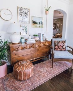 Mid century sideboard perfectly styled with a Moroccan pouf, gallery wall and vintage rug runner