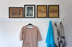 White Shaker Peg rails with shelf, framed artwork, MHL Smock shirt | Remodelista