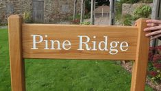 This beautiful oak entrance sign was made by The Sign Maker. The sign itself measured 750mm x 200mm. The osts wew 1.2m long and measured 70mm x 70mm. The font was Century. It was treated with Devon Oil. ref 2009.LW.066 Entrance Sign, House Signs, Sign Maker, Metal Casting, Solid Oak, Devon, Clear Acrylic, Natural Wood, Wood Signs