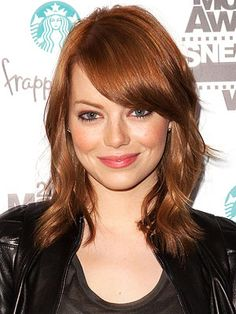 shoulder length with thicker bangs.
