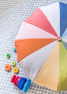 How to sew a rainbow floor pouf - free sewing tutorial perfect for a DIY colorful baby nursery! Sewing Patterns Free, Free Sewing, Sewing Tutorials, Sewing Projects, Craft Projects, Pattern Sewing, Sewing Tips, Hand Sewing, Crafts