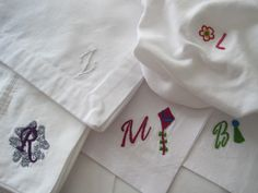 Hand stitched monograms and motifs on ready made baby tees, napkins, pillowcases and hankies. stitchbyrachel