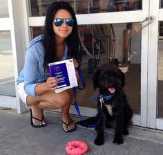 A woman on vacation has adopted the dog who defended her while she was being hassled by two men
