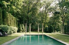An expansive pool is set into the bucolic setting of Stephen Sills Bedford property, punctuated by classical columns at one end. Photo by Fr...