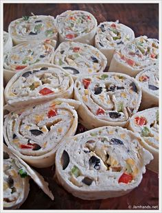 Party Pinwheels With Cream Cheese, Ranch Dressing, Green Onions, Flour Tortillas, Red Bell Pepper, Diced Celery, Sliced Black Olives, Shredded Cheddar Cheese