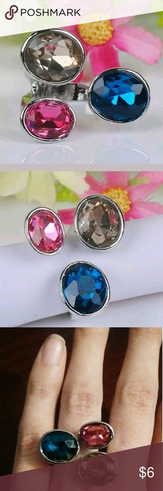 Size 7 Sterling Silver Ring With Pink & Blue Stone Size seven sterling silver ring with blue, pink and light gray colored stones. Jewelry Rings