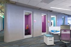 This is one example of having a certain colored carpet that compliments the rest of the office design, like the accent wall and furniture colors (in this case purple and teal). I think the base paint is a grey/tan