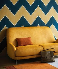 This distinctive design of this sofa adds a bit of vintage charm to your conversation space with elegantly turned legs and bold nailhead trim. Its contemporary wall lifts up the whole look of the sofa.Crafted with solid hardwood, this statement piece by @ will be a favorite seat in the home for years to come.  #yellowsofa #interiordecor #decordesign #interiordesign #designing #luxury Yellow Sofa, Interior Decorating, Interior Design, Nailhead Trim, Modern Sofa, Conversation, Hardwood, Legs, Contemporary