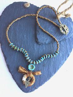 Lovely beaded blue/green and antique bronze by HandmadeByKikiJ
