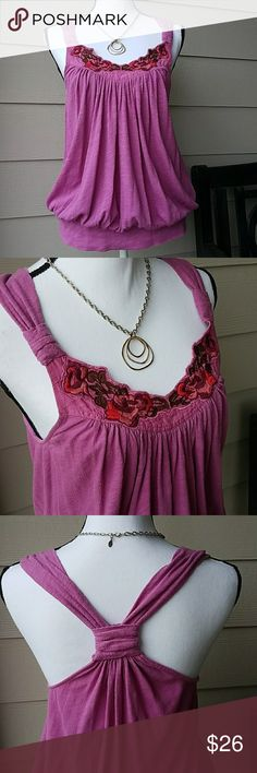 Free People Embroidery Racerback Style Tank SZ S Lightweight, 100% Cotton, Embroidery Floral Design around Neckline, Knot detail at Shoulders and Back, Gathering at Neckline and Waist for a Relaxed Flowy Look. Color is between a Pink & Purple. It is a size small but is a generous fit could also fit a medium. Please see measurements.  Washed and worn but still in excellent condition. Free People Tops Tank Tops