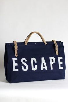 The Forestbound ESCAPE Canvas Utility Bag is made from sturdy navy blue canvas. Features strong yet soft beige leather handles and buckle straps with metal Leather Handle, Soft Leather, Painted Canvas Bags, Painted Fox Home, Blue Canvas, Summer Bags, Summer Sky, New Bag, Luggage Bags