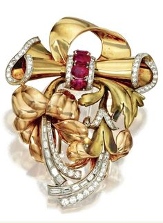 TWO-COLOR GOLD, PLATINUM, DIAMOND AND RUBY BROOCH, CIRCA 1945  Designed as a foliated bow, set with old European-cut, single-cut and baguette diamonds weighing approximately 3.00 carats, completed by 4 oval rubies.