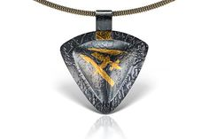 Oxidized sterling silver triangular pendant with keum boo.