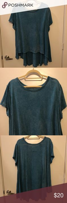 Free People Blue Flowy Top Fun Free People top, casual T-shirt material with a cool teal (almost acid wash) look. Flowy fit, longer in the back, shorter in the front like a normal top! Worn a handful of times, in great condition (had a worn look to it when I bought it, looks the exact same today!). Size XS/S Free People Tops