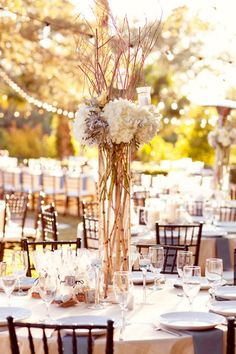 tall rustic wedding centerpiece with twigs and hydrangeas.  wrap vase with jute.