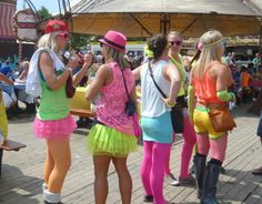 Tomorrowland ! Festival outfit summer 2013 - fluorescent clothing (neon), shorts, trendy rain boots, flowers in hair, supermanlook