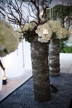 Wedding- DIY Wedding Decorations. Cheap and easy. Wood stumps shown here. But.. how bout lace wrapped vase with flowers, branches with strung crystals and candles? Using a clear vase with colored water and more sheer white or silver lace would be more eye catching. Black and white theme shown here.