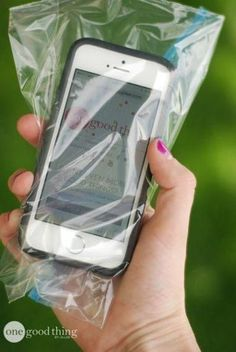 Protect your phone from sand and water by placing it in a sandwich bag.  You'll still be able to use it, while keeping it protected from the elements.  Photo: One Good Thing
