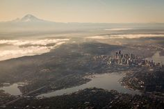 Aerial view of Seattle. Mount Rainier on the left, Downtown Seattle on middle right, Space Needle far middle right.what a sight ! The Places Youll Go, Places To See, Amsterdam, City From Above, Lake Union, Seattle Washington, Washington State, Western Washington, Famous Places
