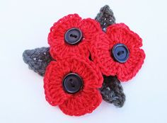 Crochet poppy tutorial on the Addicted to Making blog. Must remember this in October.