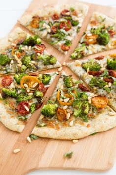 Vegetarian Pizza Toppings: Pesto, Roasted Broccoli, Dried Tomato, Pine Nut, Basil, & Mozzarella. #vegetarian #gf #ef