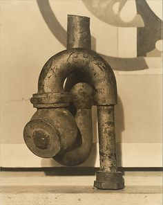 """God"" by Baroness Elsa von Freytag-Loringhoven and Morton Schamberg    a drain pipe attached to a miter box documents one of the most famous examples of American Dada."