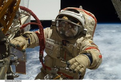 """Moonwatch. """"Russian cosmonaut wearing an Omega Speedmaster Professional in E.V.A. (Extra-vehicular activity, ie spacewalk)."""""""