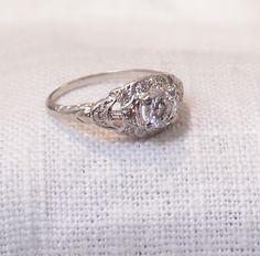 14k Gold Art Deco Diamond Engagement Ring .81 Carat by hotvintage on Etsy https://www.etsy.com/listing/223909104/14k-gold-art-deco-diamond-engagement