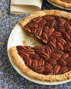 Chocolate Pecan Pie - We've made this beloved Southern dessert even more tempting by adding dark chocolate. The pie filling puffs up during baking but settles as it cools. Pecan Pie Recipe Martha Stewart, Martha Stewart Recipes, Southern Desserts, Köstliche Desserts, Dessert Recipes, Potluck Recipes, Dessert Healthy, Pie Dessert, Thanksgiving Desserts Easy