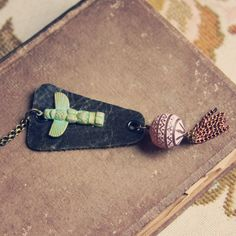 kundi. a beaded leather and tassel animal totem necklace. by RootsandFeather on Etsy