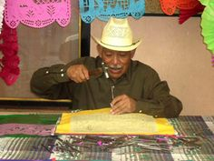Mexican papel picado banners - Sr. Reynoso has been making custom papel picados for 40 years! He is an excellent artist that uses hand made steel chisels in hundreds of shapes, every line is cut with the strike of a hammer that cuts about 30 sheets of tissue paper at a time! One wrong move and they are all ruined!