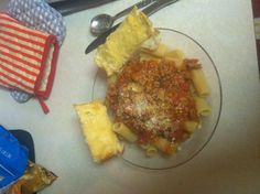 Roasted garlic French bread with mild sweet sausage tomato sauce over rigatoni
