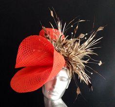 This seasons hot colour mandarine Orange. A perfect Ascot Hat.