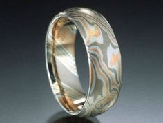 Our wedding bands- mokume gane made together to be mirror images
