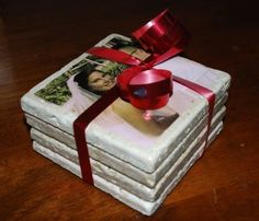Create your own coasters from your favorite pictures. love Love LOVE this idea! Can't wait to try it!! Would be great gifts also!! (I bet you could use magazine clippings also!)