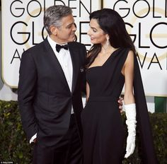 Stunning couple: George Clooney arrived with his British-Lebanese lawyer wife, Amal on his...