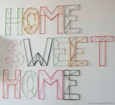 DIY Nail and Yarn Wall Art [Jen Loves Ken via Creature Comforts]