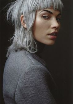 Grey blue / silver hair. Short hair