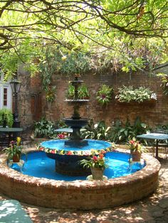 in the courtyard at the Court of Two Sisters Restaurant in New Orleans