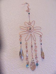 Windchime.  beads, shells & white wire coat hangers would work...
